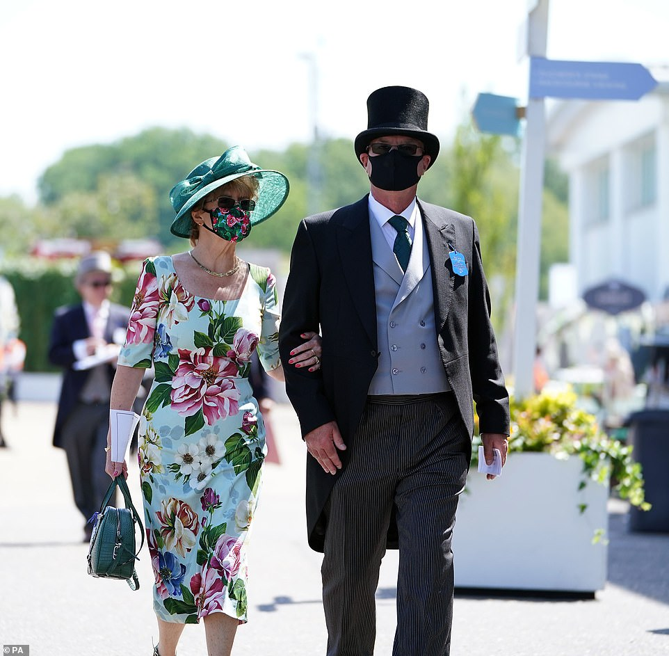 Blooming gorgeous! Another racegoer opted for a floral print number with a green hat and coordinating face mask