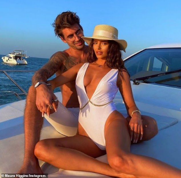 Happier times: Maura and Chris went public with their romance in November after months of speculation they were dating but took to Instagram at the start of May to confirm they had split