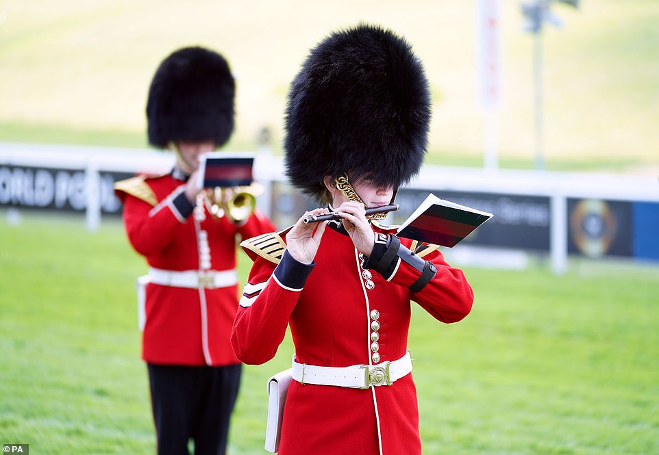 A marching band performs during day two of the Cazoo Derby Festival at Epsom Racecourse