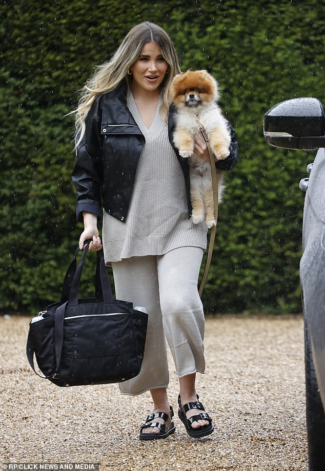 Other baby: Georgia was also seen carrying the other love in her life, her beloved dog Monkey