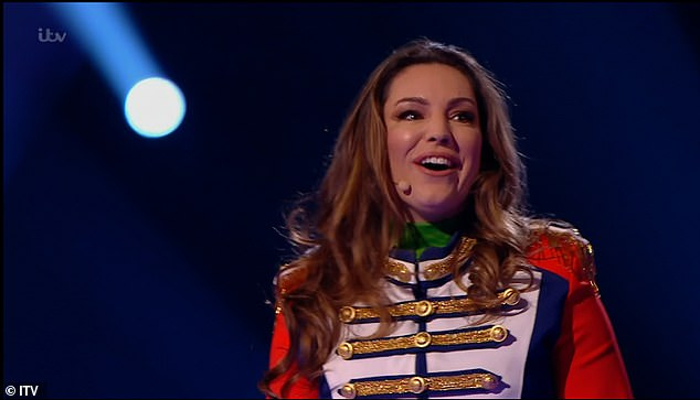 Unmasked! During Friday night's semi-final, Kelly Brook (pictured) was unmasked as Frog while Craig Revel Horwood was unveiled as Knickerbocker