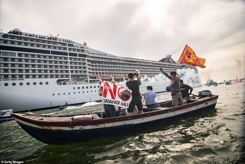 Protesters take action during the passage of the Cruise Ship MSC Orchestra on June 05, 2021 in Venice, Italy. The Italian government has decided to keep 'Large ships out of the lagoon', but while waiting for a solution, which will take years, the large ships are returning to the lagoon as Italy's tourism industry begins to get back to its feets