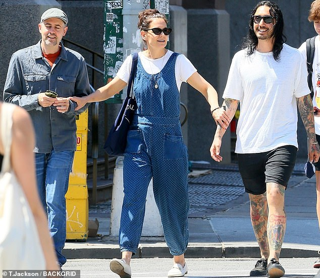 Trio:Katie at one point was seen playfully grabbing both of her friends' arms as they made their way across the street together
