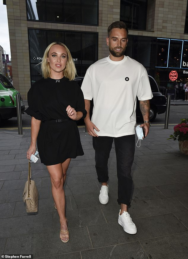 Date night:Hollyoaks actress Jorgie looked gorgeous in a thigh-skimming black dress while Ollie opted for comfort in black trousers