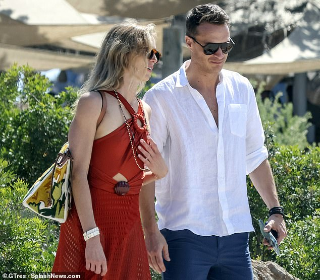 Pictures show the pair, above, looking at ease together at restaurant Casa Jondal in Ibiza