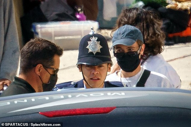 Attire: The former One Direction singer, 27, remained dressed in his policeman garb for the beach scenes