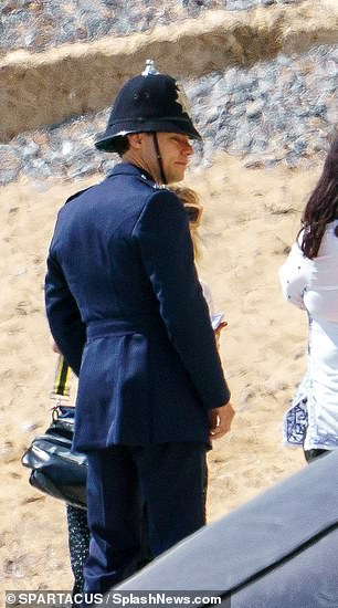 Strolling along: He was seen getting into character for the scenes
