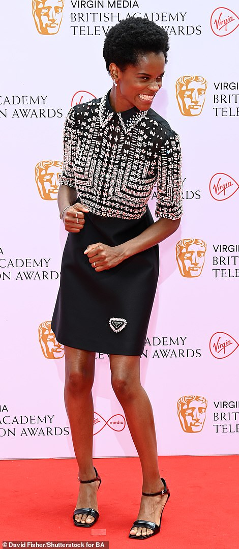 Shine bright: Nominee Letitia Wright arrived in a breathtaking black Prada dress, which was embellished with crystals on the top