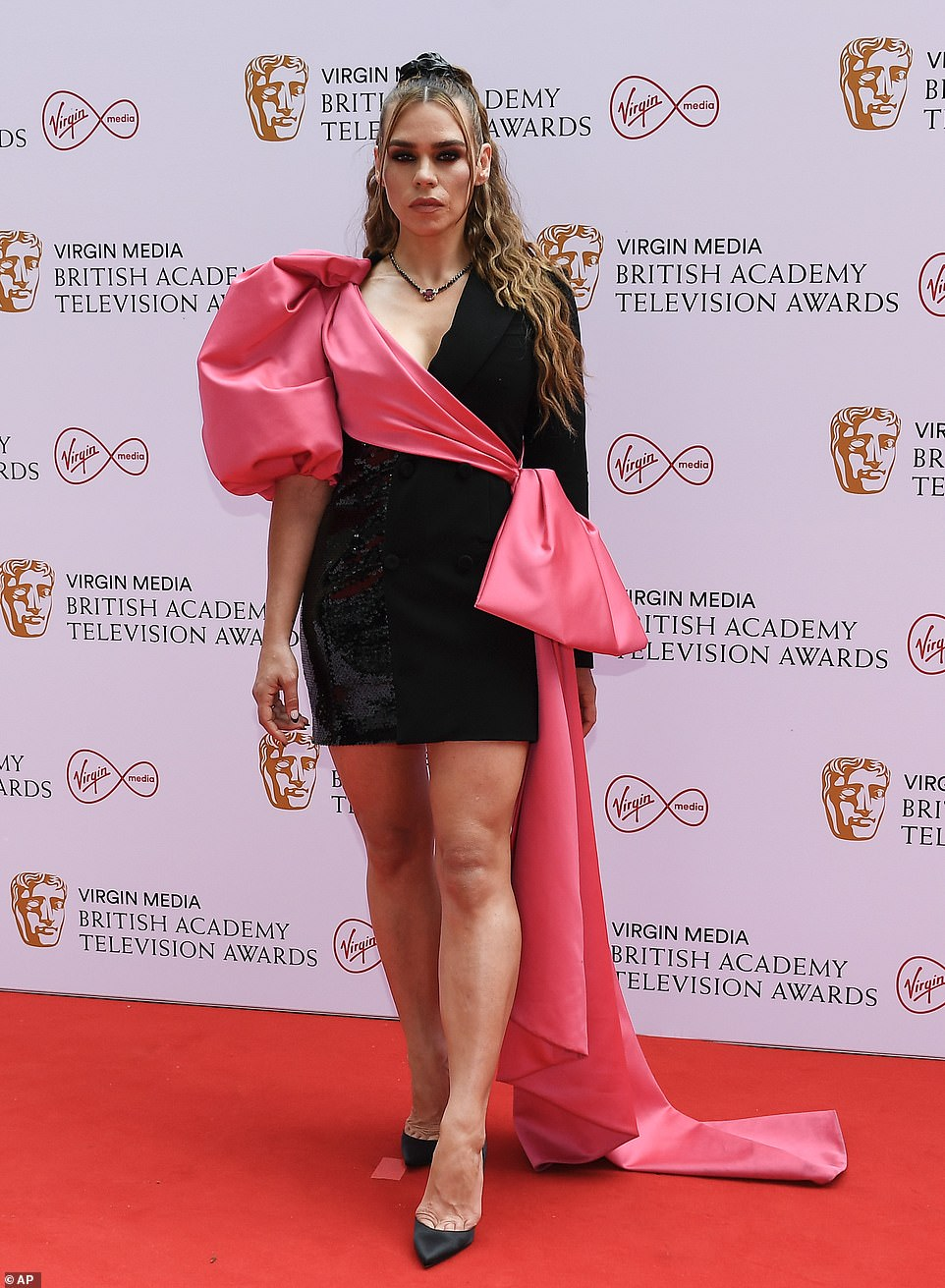 Suits you! Actress Billie turned heads as she arrived on the red carpet in a black tuxedo dress, a part of which was sequinned