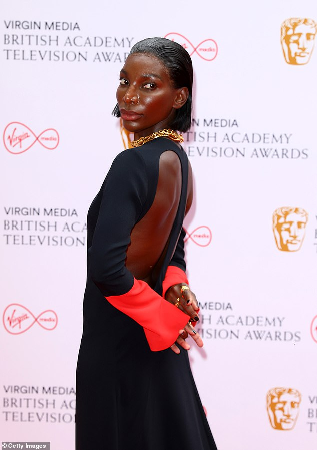 Chic: The actress and screenwriter, 33, stepped out on the red carpet in a flowing backless gown and with a statement red cuff sleeve detail