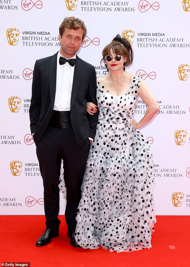Mind the gap: The actress graced the red carpet with her partnerRye Dag Holmboe who, at 33, is 22 years her junior