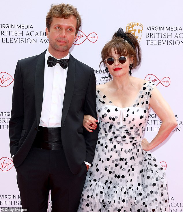 Coupling-up: Helena looked comfortable with her man by her side at the event which will be hosted byhosted by Richard Ayoade
