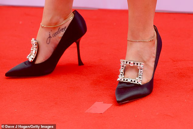 Funky:The star added a fun twist to her look by opting for quirky black jewelled stiletto heels