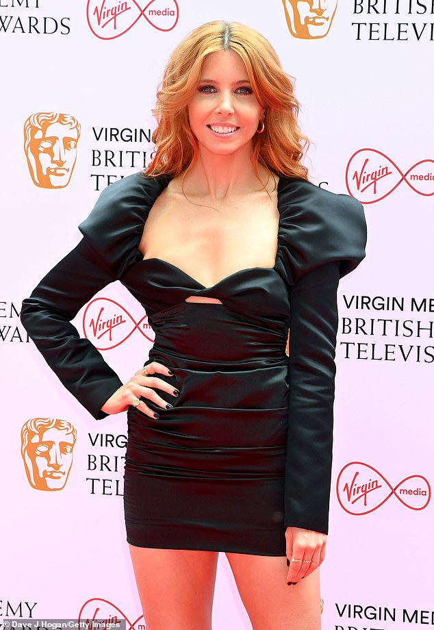 Dressed to impress:The broadcaster slipped into the LBD with a sweetheart neckline and puffed sleeves after joining Vick Hope for presenting duties