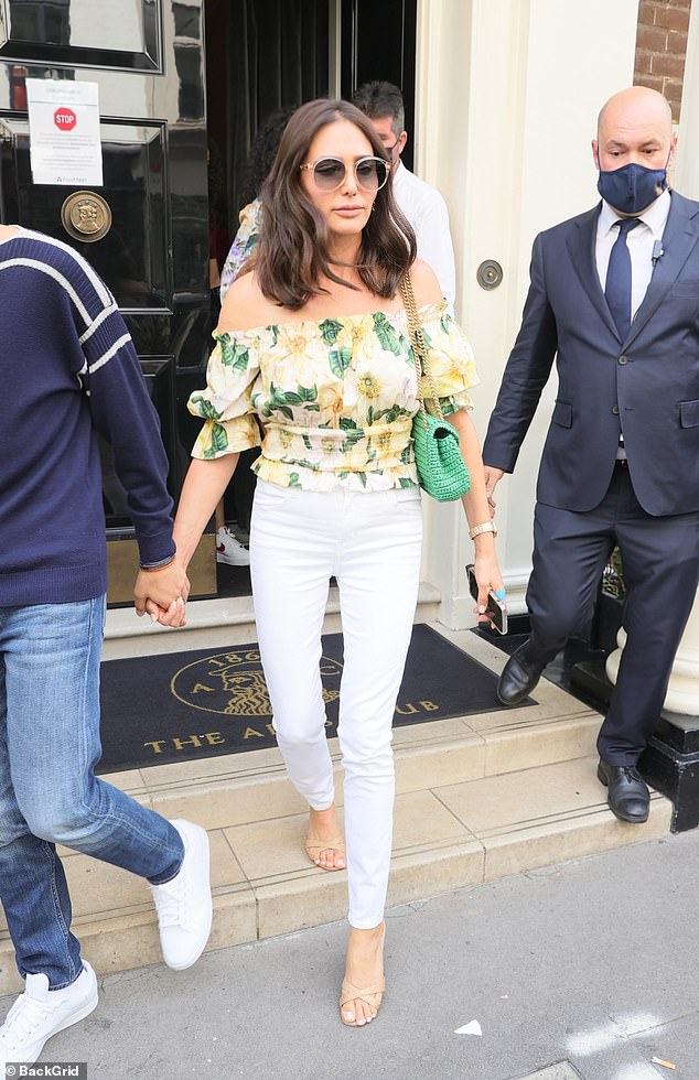 Stylish:Lauren, 43, cut a typically stylish figure in white jeans teamed with an off-the-shoulder blouse and kept the sunshine at bay behind a pair of sunglasses