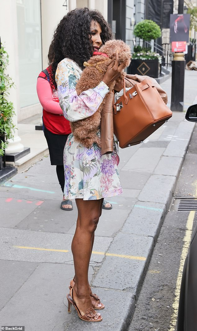 Pedicure: Sinittatoted her belongings in a chic leather handbag and showed off her immaculate pedicure in open-toe sandals