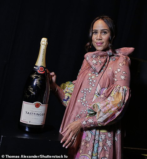 Fashion: Actress Zawe Ashton cut a stylish figure in a patterned pink gown with a statement bow as she hung out backstage