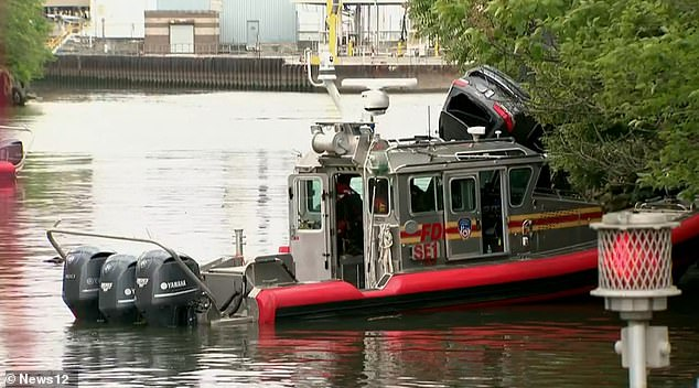 A FDNY boat took the SUV away