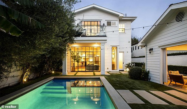 Getting out: The couple are already trying to offload one of their LA properties, having listed their smaller home in Hancock Park for $4.5million (pictured) late last month
