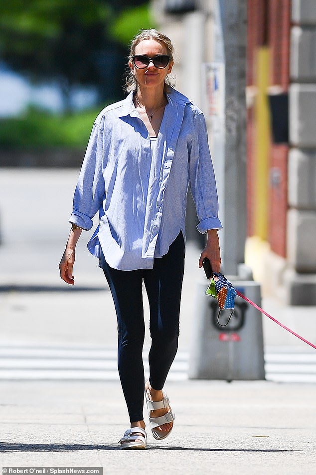 It's all in the jeans! Makeup free Naomi Watts, 52, looked incredibly youthful as she as she took her beloved dog Izzy for a walk in New York on Sunday