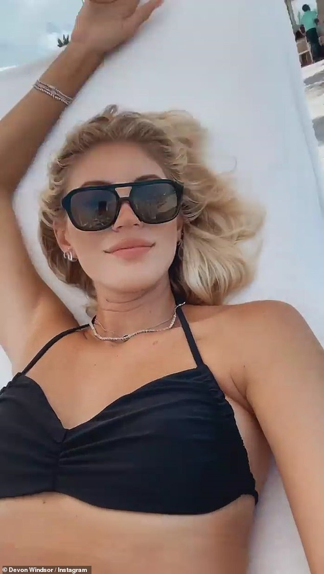 Just chillin': She also shared some selfies as she relaxed in the sun wearing a pair of large shades