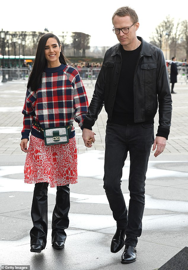 Going strong: Connelly shares her daughter and a son Stellan, 17, with husband and actor Paul Bettany; the couple, who have been married for 17-years, are pictured in Paris in March 2019
