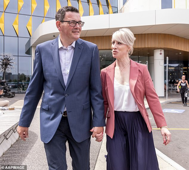 Absent Premier Daniel Andrews (pictured with his wife) was criticised for saying that Victorians are having 'another week off work' in his first social media post since April 18