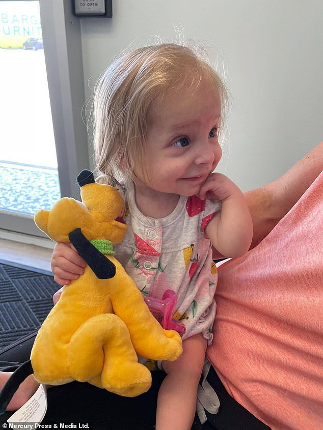 Abigail, pictured, is a healthy child and has the same appetite as a normal two-year-old, but her growth was slowed by her dwarfism, and she can't walk yet
