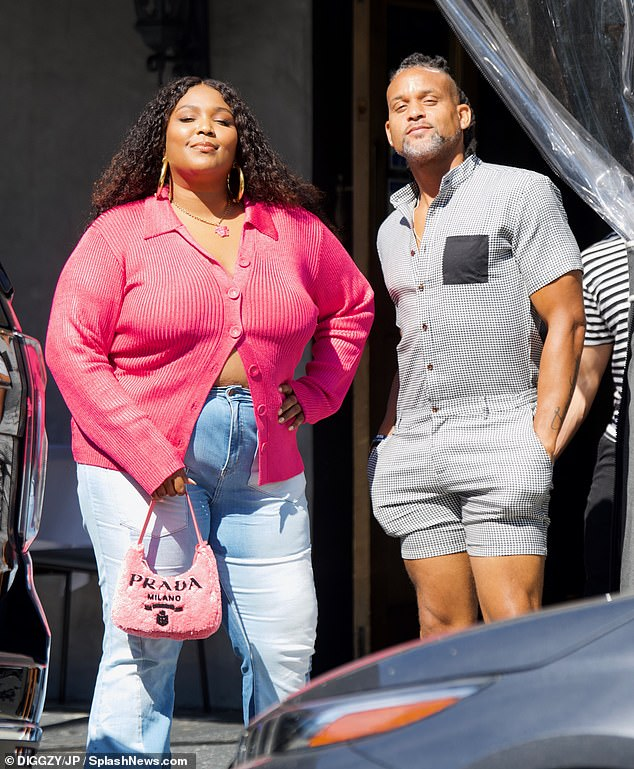 Work it:Lizzo looked effortlessly chic on Sunday as she enjoyed a vegan lunch date with her pal and fitness guru Shaun T at the Crossroads Kitchen in Los Angeles, California