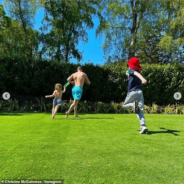 Family time:The Real Housewives of Cheshire star shared a series of other snaps of her children and Paddy playing together in the garden