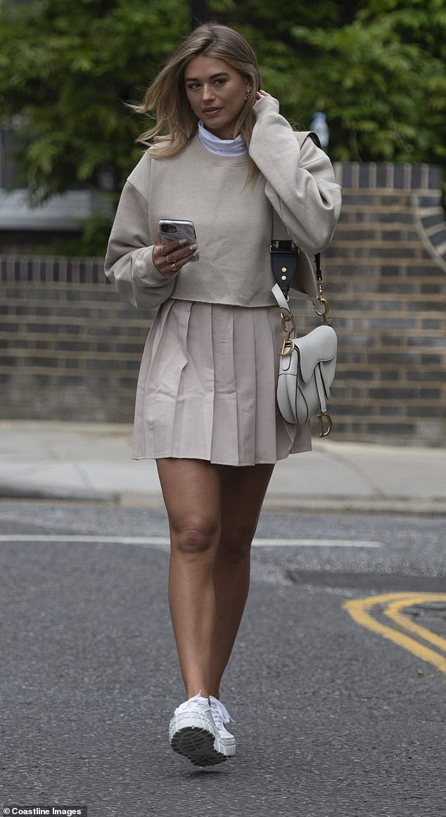 Beauty: The former Love Island star, 30, stepped out in the beige skater skirt which showcased her toned pins and added a cropped jumper