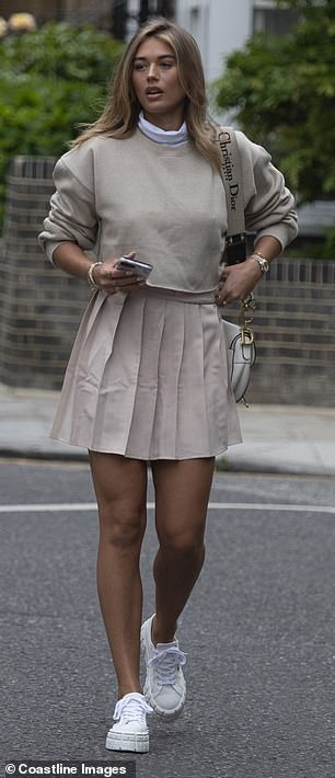 Stunning: Proving she has expensive taste, Arabella draped a Christian Dior bag over one shoulder
