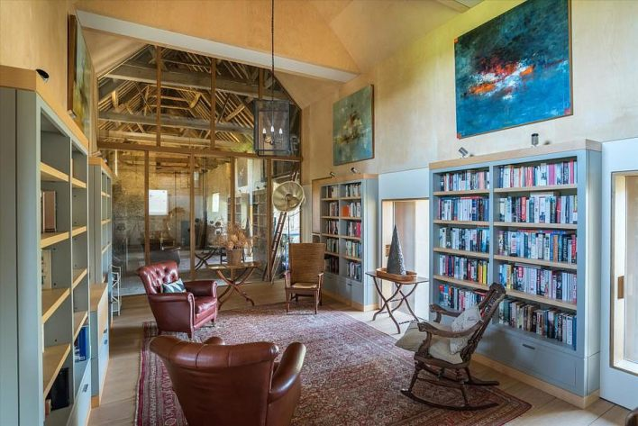 Read away!As well as a room that could be designated as a library of sorts, the house also features classic wooden furnishings and simple whitewashed walls
