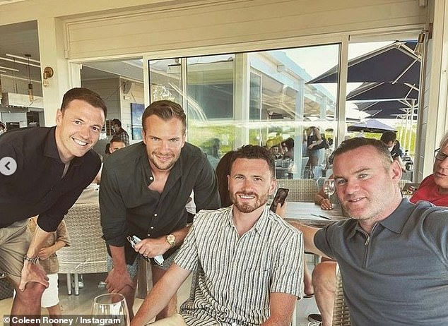 Boys' night:The fourth of Coleen's photos saw Wayne kicking back with Tom Cleverly, 31, and two other male friends at a restaurant