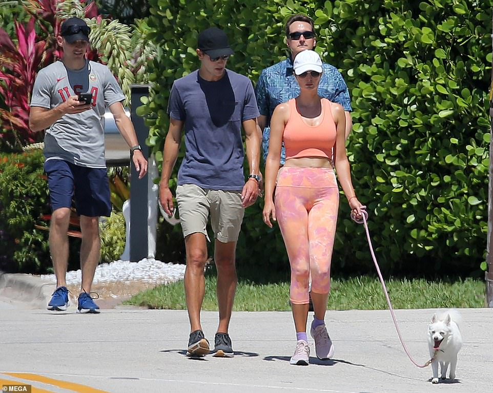 The couple that walks together... The former First Daughter, 39, was joined by her husband Jared Kushner, 40, and two burly Secret Service agents, who followed on closely behind the couple as they strolled along in the heat