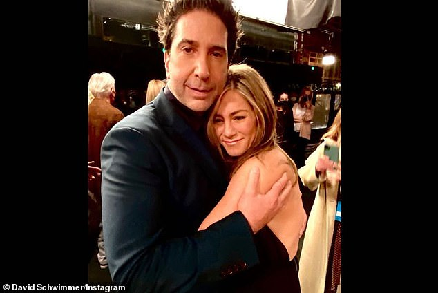 'Last hug of the night': David Schwimmer delighted Friends fans once again as he posted a plethora of behind-the-scenes reunion snaps to his Instagram account on Monday, including one of himself embracing Jennifer Aniston