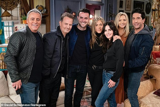 Lights, camera, action! The slideshow also included this snap of the cast with the Friends: The Reunion director Ben Winston