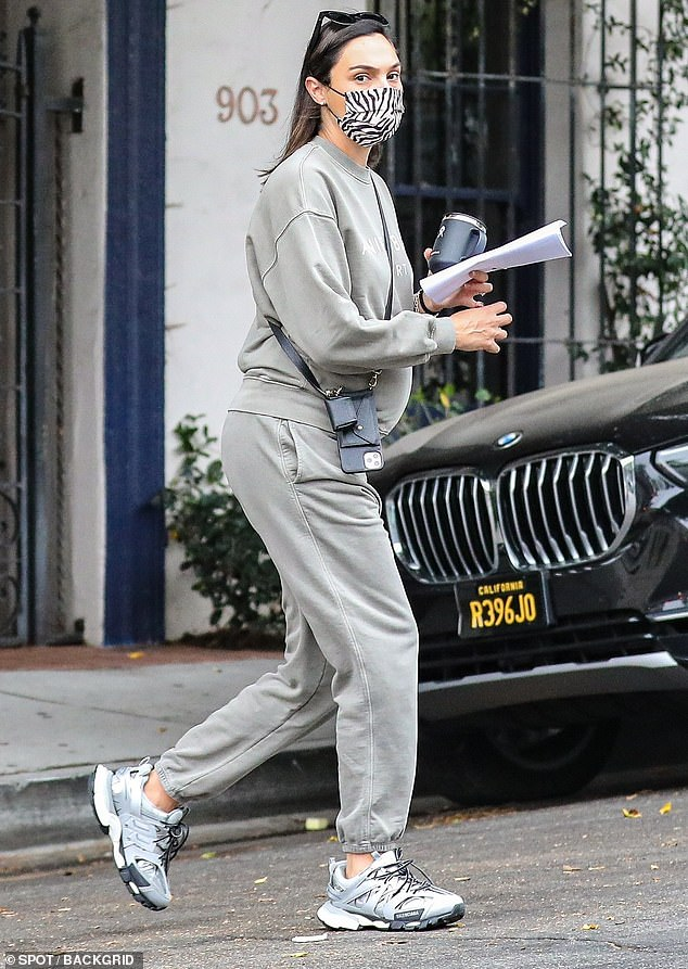 Gal on the go: Expecting star Gal Gadot dressed in comfy grey sweats while visiting a Beverly Hills hair salon on Monday