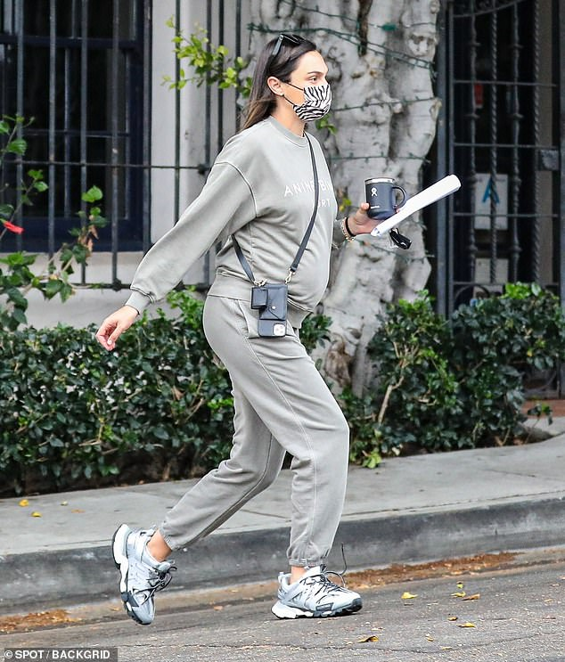 Me time:The Wonder Woman star, 36, hid her burgeoning baby bump under a soft, grey sweat suit while seen leaving the celeb-beloved Nine Zero One Salon on her own