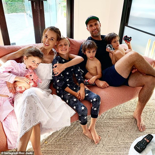 Family:Rebecca (pictured with her husband, AFL great Chris Judd, and their children) made headlines last September when she criticised Mr Andrews for his draconian lockdown laws