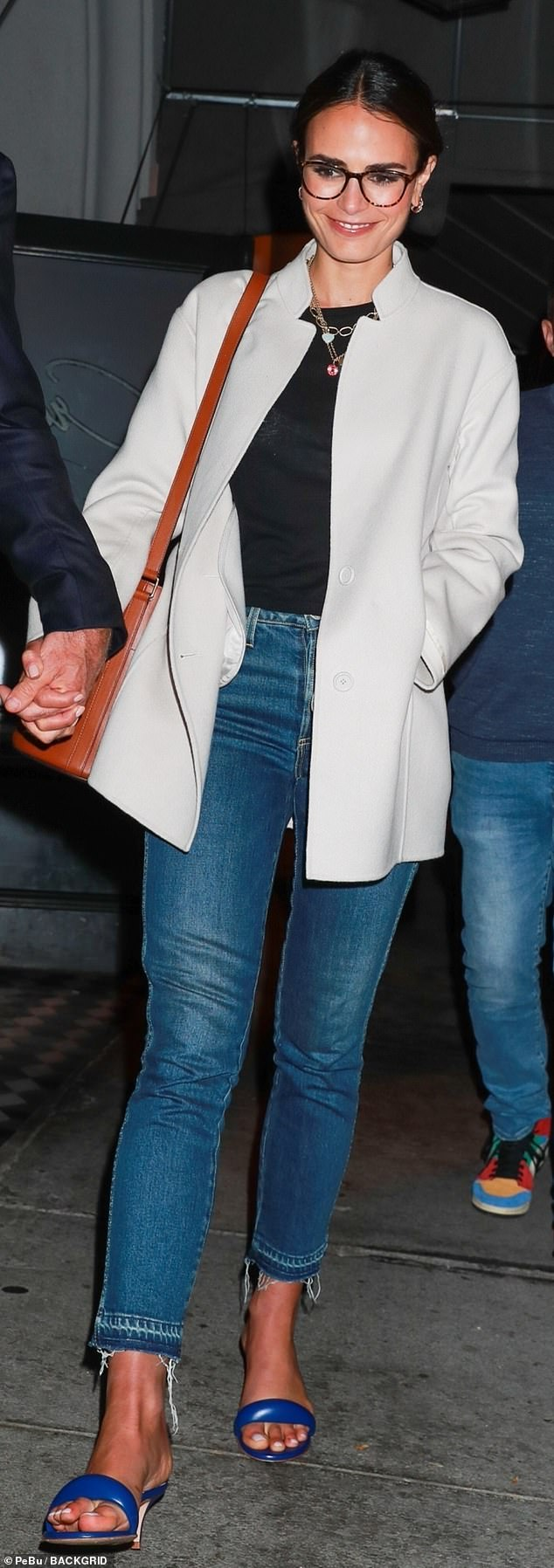Relaxed: The Fast & Furious star, 41, kept her look casual, pairing a black t-shirt with blue jeans cropped above the ankle and stepping out in blue slides