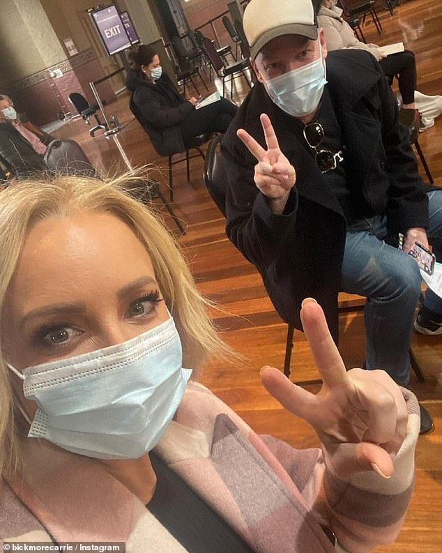 In good company: Carrie was joined by The Project co-host Peter Helliar on Monday as they waited to receive their vaccine