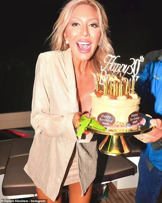 Birthday:She's then seen holding a cake with her daughter lighting the candles, before she releases a large balloon into the sky