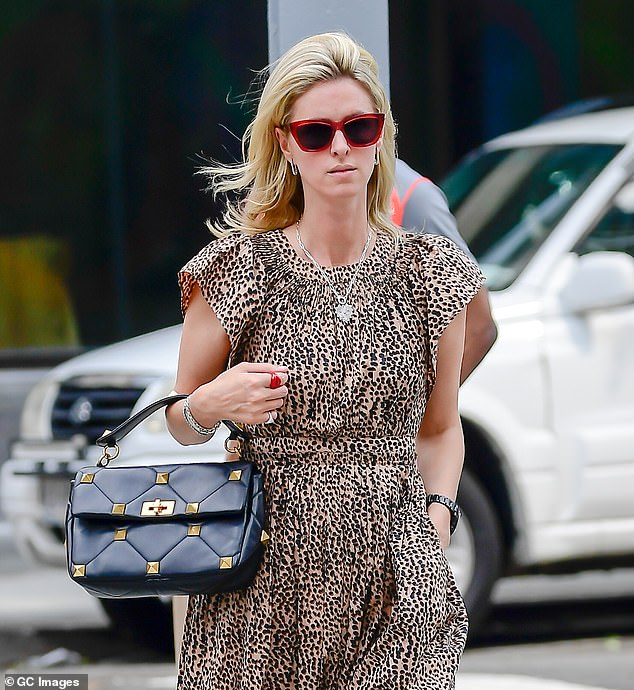 Gorgeous: Nicky paired her outfit with red framed sunglasses, a silver heart necklace, bangles and a pair of drop earrings