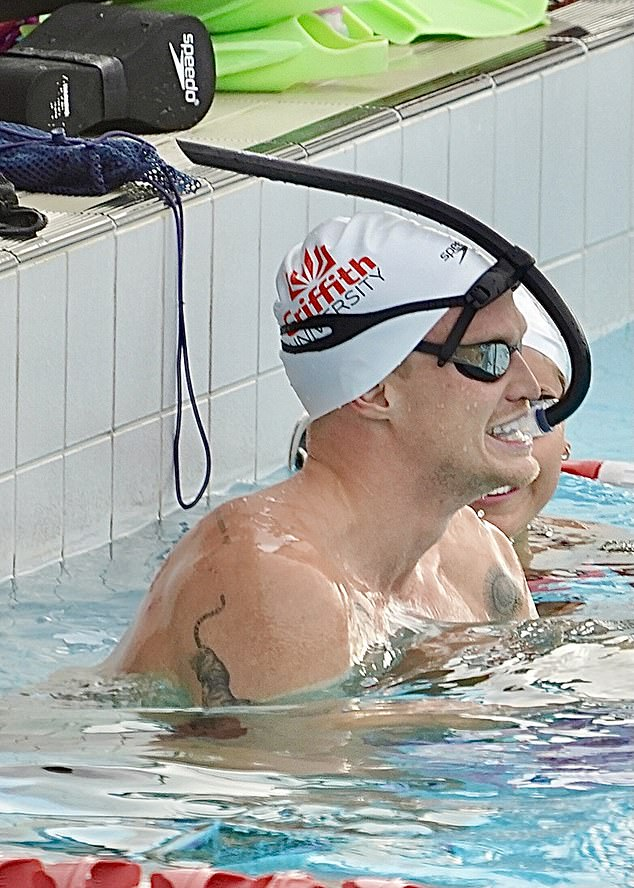 Not letting the pressure get to him: At the end of training, Cody enjoyed a few leisurely laps in the pool