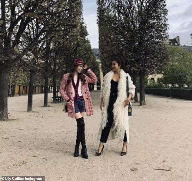 Fun times:Lily Collins was living her best life in the City of Light as she revealed she'd been out to celebrate her co-star Ashley Park's birthday on Monday