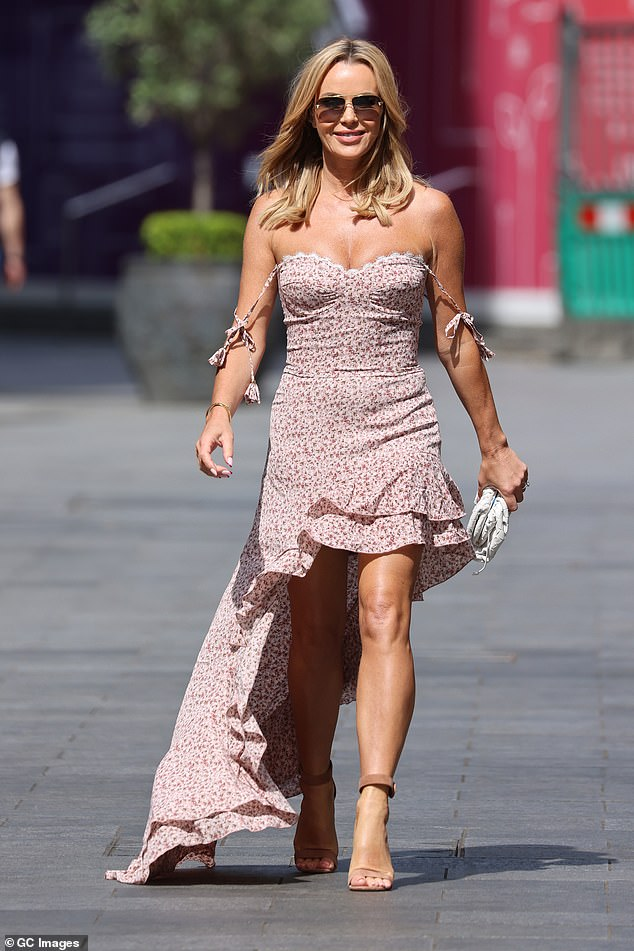 Glowing: Amanda Holden, 50, looked radiant as she put on a busty display in a flowing summer dress for her shift at Global Studios on Tuesday