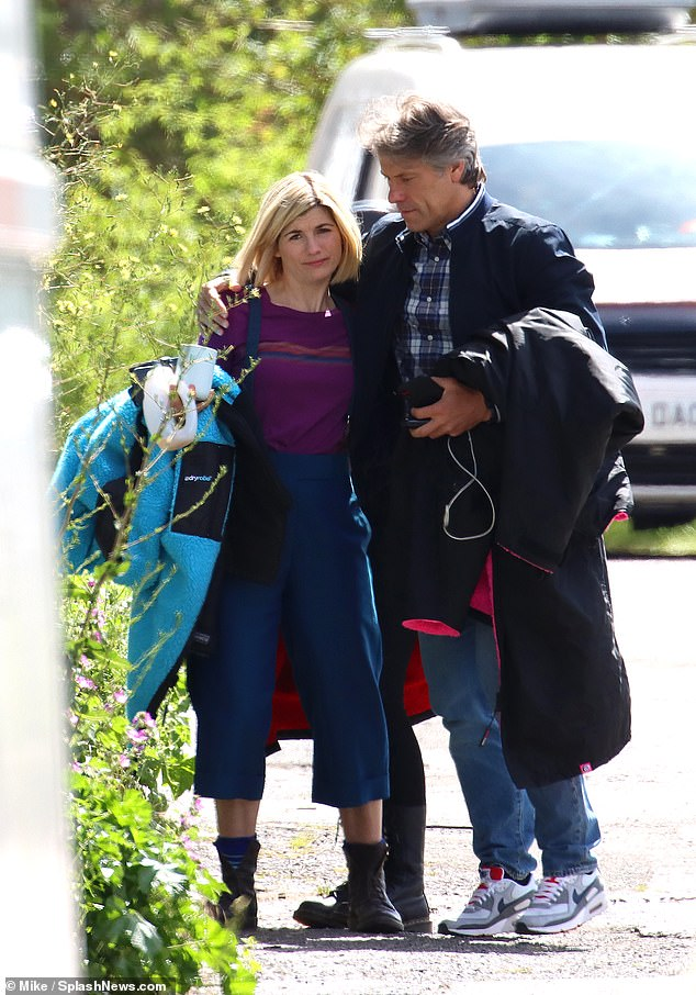 Upset? While it is unclear why Jodie needed a hug from her co-star, she appeared downcast as John offered to comfort her