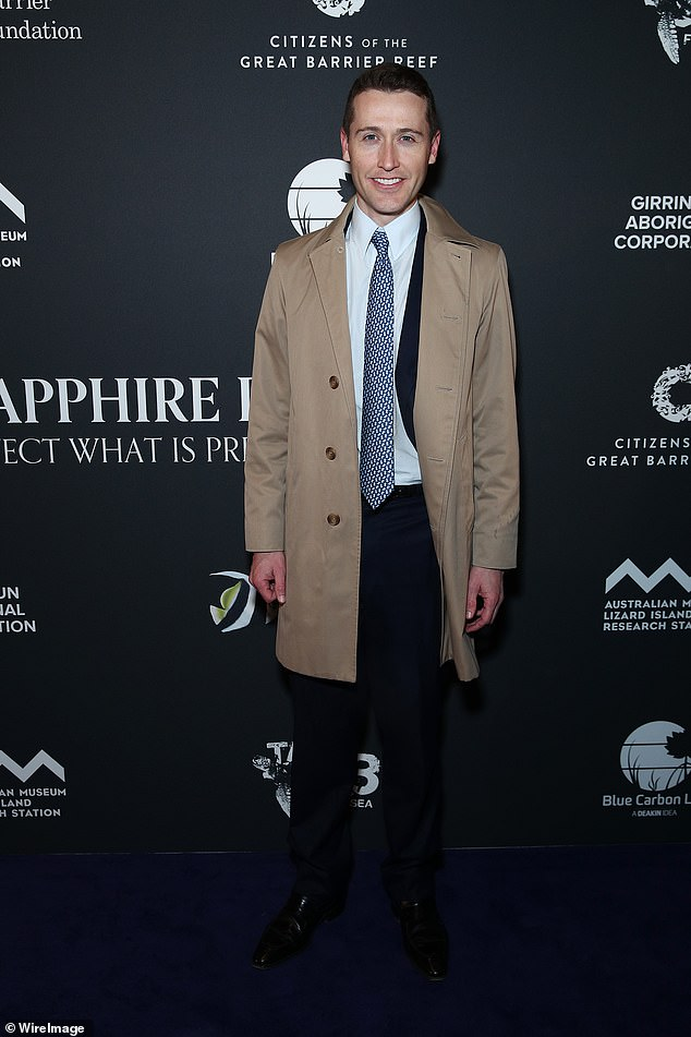 Covered up: Tom Waterhouse also stepped out for the launch, donning a classic camel-coloured trench coat