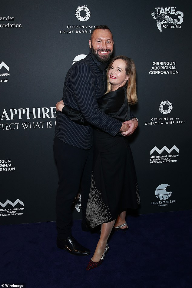 Hug it out: It wasn't just Valerie who was charmed by the former freestyler, with Tourism Australia director Hayley Baillie wrapping her arms around him in a hug